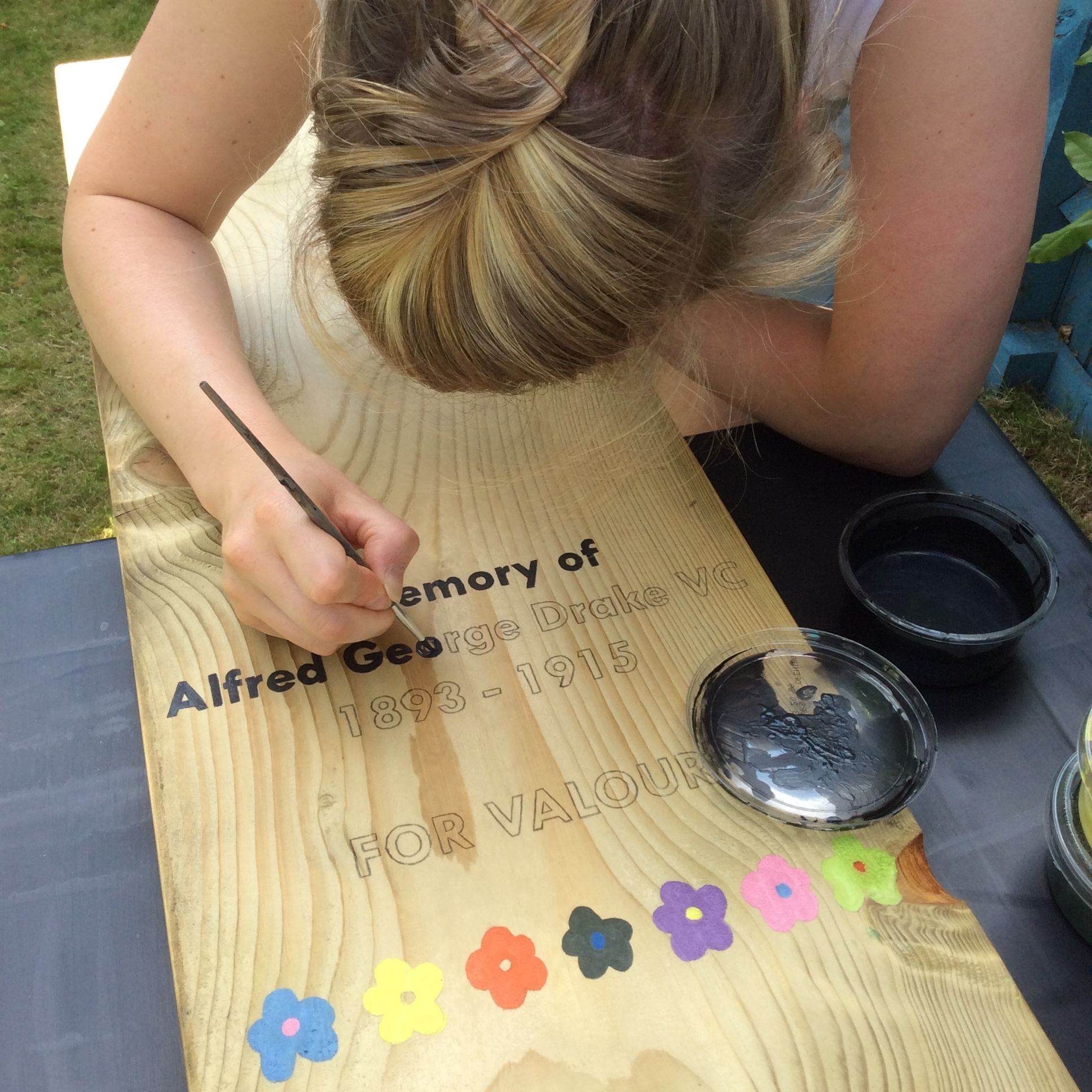 Finishing the painting on the Memorial Artwork wooden blocks (Ben Jonson Primary School)